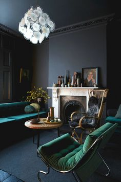 jewel tone interiors emerald green armchair and deep teal sofa with charcoal…
