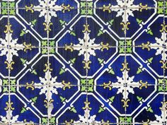 Azulejo, a Portuguese tile. In Gentian blue, black blue, pale green & white diamond pattern with floral centre.