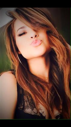Becky G kisses