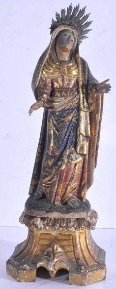 Imagem em madeira esculpida, entalhada, pintada e dourada, representando Nossa Senhora das Dores. Altura 28 cm. Altura com peanha 37 cm. Brasil, século XIX. Base R$3.000,00. Não vendida.
