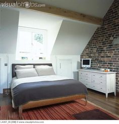 bedrooms with dormers | Converted attic double bedroom with exposed brick  wall and dormer .
