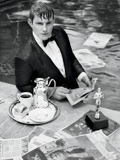 Okay, kids, here's a young star engulfed by newspapers: Alexander Ludwig.
