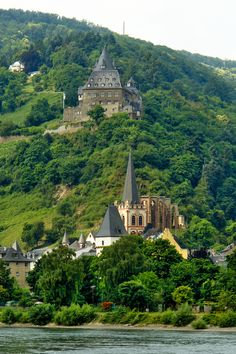 """The Stahleck Castle is a 12th-century fortified castle in the Upper Middle Rhine Valley at Bacharach in Rhineland-Palatinate, Germany. It stands on a crag approximately 520 ft above sea leve on the left bank of the river at the mouth of the Steeg valley, and offers a commanding view of the Lorelei valley. Its name means """"impregnable castle on a crag"""", from the Middle High German words stahel(steel)and ecke (here: crag) It has a water-filled partial moat, a rarity in Germany."""