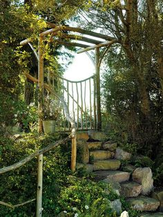 Arbor at the top of garden stairs