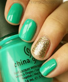 Pretty blueish/teal with gold sparkles ring finger accent.