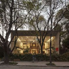 Elena Garro Cultural Centre,  Coyoacán, Mexico .  Fernanda Canales and Arquitectura 911sc wrapped a concrete and glass frame around the front of an old house in Mexico City to convert the building into a library / bookstore