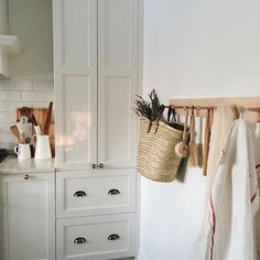 Could paint side tables in bedroom the color of the cabinets with the same black hardware, or even antique gold... Also, gonna add a peg rack to our bedroom for some functional decor!
