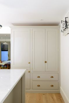 A beautiful Shaker pantry cupboard with integrated fridge freezer painted in our popular 'Mushroom' colour