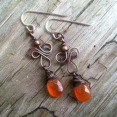 Antique Copper and Carnelian Gemstone Celtic Wind Wire Work Dangle Earrings.  This is my variation of a tutorial I bought from JewelryLessons.com called Celtic Wind.  This light weight earring hangs 2