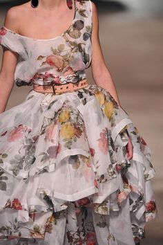 Runway dress by Vivienne Westwood. Love the floral, off the shoulder, layers, peach belt. Everything = perfection.