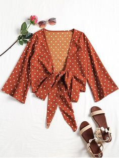 Plunging Neck Polka Dot Tied Blouse. This casual blouse features a sexy plunge collarline, retro polka dot pattern throughout and three-quarter sleeves, as well as a big bowknot tied at front. #zaful #tops #outfits