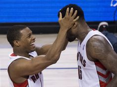 Toronto Raptors guard Kyle Lowry, left, celebrates with Amir Johnson after Johnson scored against the Brooklyn Nets late in the second half of Game 2 in an NBA basketball first-round playoff series, Tuesday, April 22, 2014, in Toronto. Toronto won 100-95. (AP Photo/The Canadian Press, Nathan Denette)