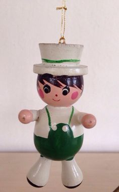 A personal favorite from my Etsy shop https://www.etsy.com/listing/249760522/vintage-hand-painted-wood-ornament-boy