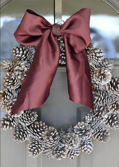 do it yourself divas: DIY: Pinecone Wreath (Practically FREE).hot-glue pony beads (or sim) to bottom of pine cones to fit on wire hanger :) Noel Christmas, Christmas Wreaths, Christmas Bulbs, Christmas Decorations, Christmas Ribbon, Modern Christmas, Thanksgiving Decorations, Beautiful Christmas, Christmas 2019