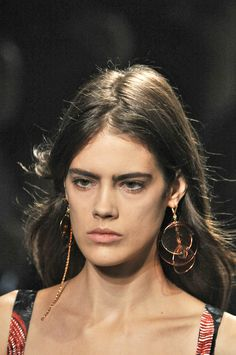 Editorialist's definitive roadmap to top trends of spring 2015 including mismatched earrings.  https://editorialist.com/magazine/12055/spring-summer-2015-accessories-report#0