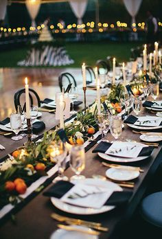A greenery and orange garland stands out against this elegant black-and-white reception table. Wedding Centerpieces, Wedding Decorations, Table Decorations, Decor Wedding, Wedding Reception, Wedding Day, Reception Table, Wedding Tables, Destination Wedding