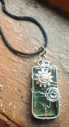Green Glass Framed in Silver Embellished with Sun by Eldwenne, $28.00