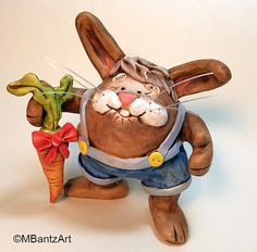 One of a kind bunny named Arnold.  Polymer clay over glass by Mercedese Bantz Art