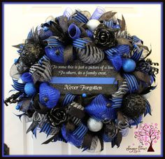 Law Enforcement Memorial Wreath, Police Wreath, Law Enforcement, Wreath, Sheriff Wreath, Door Wreath, Black and Blue Wreath by SugarTreeDecor on Etsy https://www.etsy.com/listing/268054276/law-enforcement-memorial-wreath-police