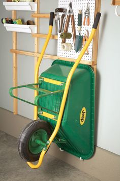 12 garage storage tips- gotta do this! wheelbarrow is such a space hog, would be nice to get it off the garage floor Spring is here, and now is the time to organize your garage. Here are some tips for maximizing storage space. Tool Wall Storage, Storage Shed Organization, Garage Organisation, Garage Storage Solutions, Diy Garage Storage, Garden Tool Storage, Garden Tools, Garage Shelving, Storage Ideas