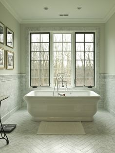 window, marble trim, marble herringbone floor, tub