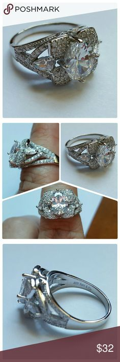 18k WGP, 925 white Sapphire Ring NWOT This stunning ring keeps on sparkling. 925 sterling silver. Layered with 18K white gold for durability. 3.25 ctw White Sapphire. Total weight 5.6 grams. Size 7. Brand is Samuelle and Co, sold through Glamouresq. Samuelle And Co  Jewelry Rings