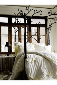 Nature meets the bedroom. Love the leaves on the bed frame.