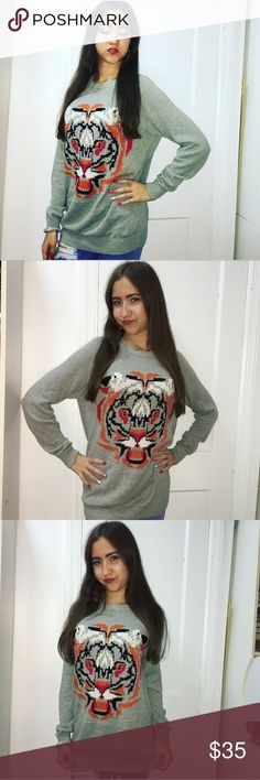 """Cozy Tiger Sweatshirt Cozy Tiger Sweatshirt  ~Features~ 🔮Complementary colored stripes   🔮Cute graphic design  🔮Comfortable and cozy  💜15% of 2 or more times when you bundle 💜Offers welcome 💜Click """"Add to bundle"""" so I can send you a private discount  ❌No trades Tops Sweatshirts & Hoodies"""