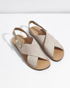 These stylish sandals come in a choice of nubuck leather or calf hair. Made in Italy, they have two thick straps that cross over at the front and popper closure. Featuring a moulded rubber tread sole for comfort, wear with day dresses, jeans or tailored trousers for a contemporary look.