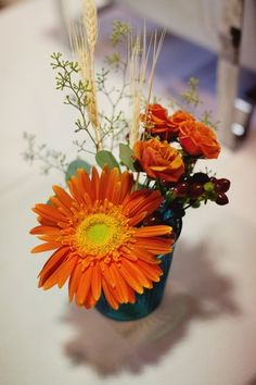 orange, reception, floral, centerpieces, flowers, gerber daisies, rose, rustic, colors, sissy, Ann Arbor, Michigan
