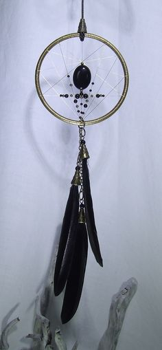 Check out this item in my Etsy shop https://www.etsy.com/uk/listing/287508753/brass-and-black-dream-catcher-wall