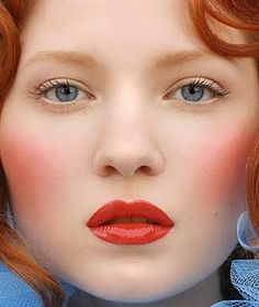 Red lips, red blush. Perfect.