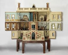 """Dollhouses are a very weird phenomenon. What's so likable about a tiny replication of our own dwellings — or very different ones — in 1:12 scale? But dollhouse popularityis assured: they've been bestsellers in toy stores since their beginnings as """"b"""