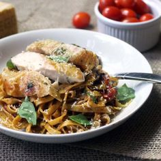 Easy winter roasted chicken pasta tossed with roasted cherry tomatoes, balsamic vinegar, parmesan and basil. One pan dish.