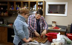 James Tranchemontagne, owner of the Frog & Turtle restaurant in Westbrook, shows Brittany Bean, 17, of Windham, how to slice onions while pr...
