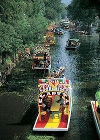 Xochimilco, decorative boats on Mexican river. Photograph by Getty Images. SHD TRAVEL MARCH 4 MEXICO CITY 20 REASONS. DO NOT ARCHIVE. Mexico...