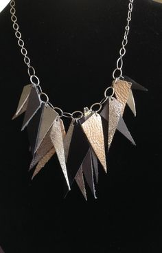 Metallic Leather Statement necklace in Metallic Silvers, Gold, and Black with Antique Silver Chain and Findings on Etsy, $40.00