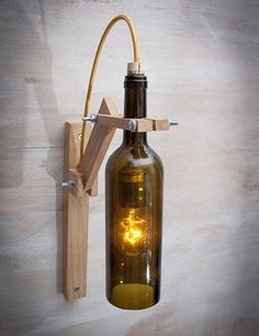 brown glass bottle wood wall sconce wood lamp wine gift wall light wine bottle lamp wine bottle decor wine bottle light recycled glass - Wood Design - modern mobilya ve raf sistemleri Wine Bottle Wall, Lighted Wine Bottles, Bottle Lights, Wine Bottle Chandelier, Diy Bottle, Brown Glass Bottles, Handmade Lamps, Wooden Lamp, Recycled Glass