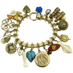 This wonderful vintage bracelet features Victorian bookchain design with a fold over clasp and a many vintage charms including an engraved locket, a piar of gold filled binoculars, several fobs or drops, a floating opal charm, A floating glitter charm, several faux pearl charms, a rhinestone charm, a charm with a carved bone fish, a carved rose charm an blue antique glass heart charm (has crack which is hard to see) and many others.pApprox. measurements of the bracelet is 7 3/4' while the center Engraved Locket, Victorian Life, Locket Charms, Bone Carving, Antique Glass, Heart Charm, Jewelry Bracelets, Opal, Vintage Bracelet