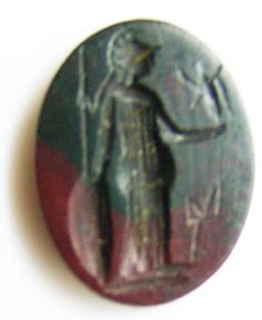This is an ancient Roman heliotrope hardstone intaglio of Minerva (Athena), dating to the 2nd century AD. It depicts a full figure of the military goddess, holding Victory. It is cut on heliotrope (bloodstone) with a good red and green colour. This depiction of Minerva was popular with the military, being set into gold and silver signet rings used to seal important dispatches and letters back home. This goddess was patronized by military commanders as the perfect warrior goddess, consulted…