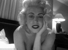 Lady Gaga pays tribute to Marilyn Monroe the best way she can on the same day she breaks records online