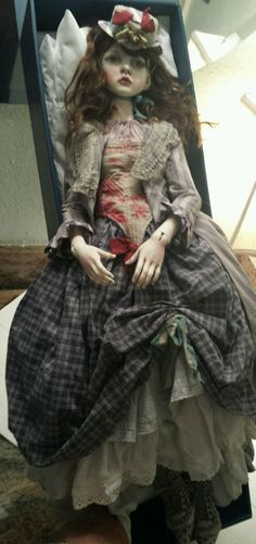 This is a gorgeous doll from Connie Lowe. The doll is a Dollstown Amy complete with everything including hat, wig, eyes, outfit. She is larger than a regular SD. She is also the doll in Haute Doll magazine's ad for Marbled Halls in the September/October issue on page 5.