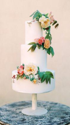 Flower and buttercream wedding cake in peach, pink, and yellow https://heyweddinglady.com/italy-destination-wedding-shoot-tuscan-villa/ #wedding #weddings #weddinginspiration #cake #weddingcake #dessert #fineartphotography #filmphotography #weddingphotography