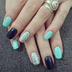 Mint and navy nails with silver glitter