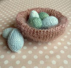 My love affair with spring is in full bloom this year and is evidenced  here by this quick little knit. A fuzzy nest of pale blue eggs is  exactly what spring is about, delicate beauty and budding life. Unlike  all of our practical knitting concerns, like warm hats and machine  washable baby blankets, this project is perfectly frivolous. Perched on a  mantel or a windowsill, it will simply make you smile.  To achieve a nest-like fuzziness, I used Lorna's Glory, a blend of wool and mohair…