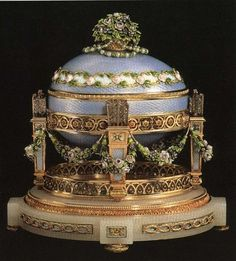The 'Cradle with Garlands' Faberge Egg ~ made in 1907 ~ for Czar Nicholas II to present to his Mother. This egg was commissioned to celebrate the birth of Czarevich Alexei Nicholaievich, son of Czar Nicholas II ~ the long awaited heir to the Romanov throne. The surprise inside was the first portrait of the Czarevich in a medallion surrounded by diamonds. This egg is currently in a private collection.