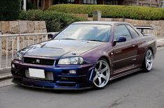 Superieur Nissan Skyline R34 GTR Vspec II Nür In Midnight Purple.