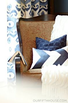 Dark blues and fun patterns for a chair tucked in the corner of the bedroom.