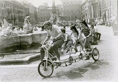 Jon Voight, Robby Kiger, Roxanna Zal and Son Hoang Bui ride a bike.