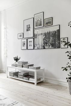 Home Design Ideas: Home Decorating Ideas Modern Home Decorating Ideas Modern Black and white gallery wall for a white on white interior. Adding some color wi.